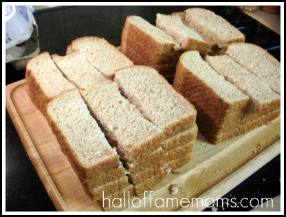Cut bread vertically to make dipping sticks.