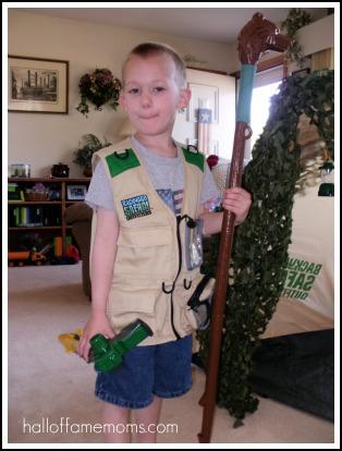 Backyard Safari Outfitters vest, walking stick, and bug wrangler.