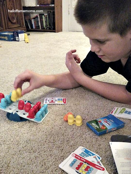 Playing Balance Beans by Thinkfun. See our family's list of favorite games here!